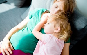 stock-photo-baby-girl-two-years-old-sleeping-on-a-pregnant-mothers-stomach-mother-and-daughter-together-435012361